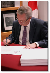 Chief Electoral Officer Marc Mayrand signs