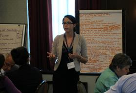 Andrea Landry presents a summary of the working group session on reaching the hard-to-reach